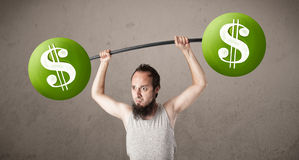 Skinny guy lifting green dollar sign weights Royalty Free Stock Image