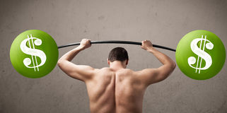 Skinny guy lifting green dollar sign weights Royalty Free Stock Photos