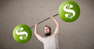 Skinny guy lifting green dollar sign weights Royalty Free Stock Photo