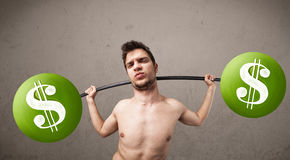 Skinny guy lifting green dollar sign weights Stock Photos