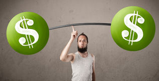 Skinny guy lifting green dollar sign weights. Funny skinny guy lifting green dollar sign weights royalty free stock images
