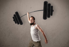 Skinny guy lifting incredible weights Royalty Free Stock Photography