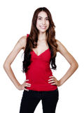 Skinny Hispanic Woman Smiling With Arms Akimbo Royalty Free Stock Images