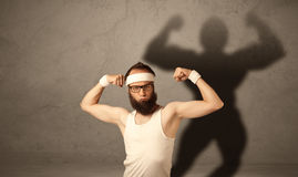 Skinny man with musculous shadow Royalty Free Stock Images