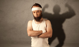 Skinny man with musculous shadow Stock Photos
