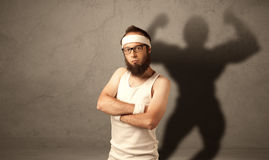 Skinny man with musculous shadow Stock Image