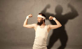 Skinny man with musculous shadow Stock Photo