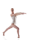 Skinny redhead gymnast posing in white leotard Royalty Free Stock Photo