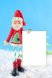 Skinny santa with blank sign Royalty Free Stock Image