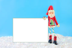 Skinny santa with blank sign Stock Images