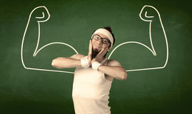 Skinny student wants muscles. A young man with beard and glasses posing in front of green background, imagining how he would look like with big muscles Stock Photos