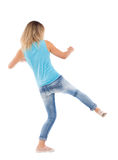 Skinny woman funny fights waving his arms and legs. Royalty Free Stock Images