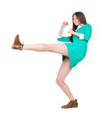 Skinny woman funny fights waving his arms and legs. Stock Images