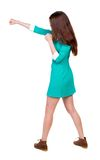 Skinny woman funny fights waving his arms and legs. Royalty Free Stock Photo