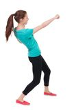 Skinny woman funny fights waving his arms and legs. Stock Photo