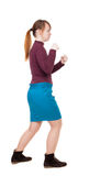 Skinny woman funny fights waving his arms and legs. Royalty Free Stock Photos