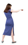 Skinny woman funny fights waving his arms and legs Stock Photos