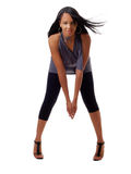 Skinny young black woman in pants and grey top Royalty Free Stock Photography