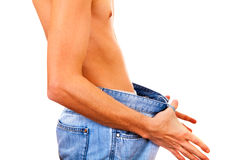Skinny Young Man. In the Jeans Isolated on the White Background Stock Photos