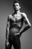 Skinny young man posing fashion, slim body Royalty Free Stock Photography