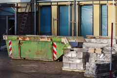 Skip on a construction site Stock Images