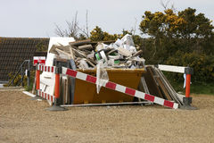Skip full of rubbish Stock Photography