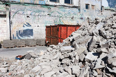 A skip full of rubble on construction site Stock Photo