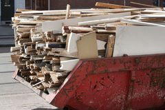 Skip loaded with old wood Stock Photo