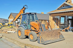 Skip Loader/Backhoe. This piece of vital machinery is valuable to job sites for moving earth and rocks as well as digging and trenching Stock Photos