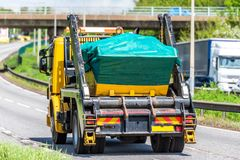 Skip lorry truck on uk motorway in fast motion.  royalty free stock photos