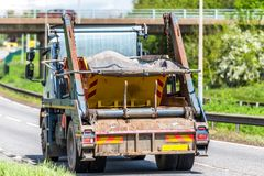 Skip lorry truck on uk motorway in fast motion.  royalty free stock images