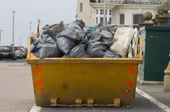 Skip with refuse/trash sacks Stock Images