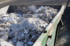 Skip with rubble. Rented skip with renovation rubble Royalty Free Stock Photography