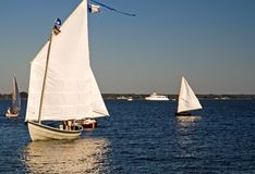 Skipjack Sailing on the Chesapeake Bay. A skipjack sailing boat once used to harvest oysters from the Chesapeake Bay about to dock at the Chesapeake Maritime Stock Photo