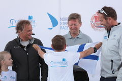 Skipper Alexander Holstein get the pennant from a teen athlete Royalty Free Stock Images