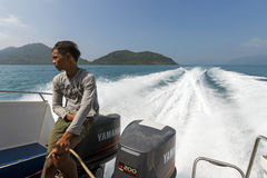 Skipper on baot. Skipper on the deck of a speed boat at the coastlines of Koh Chang in Thailand Royalty Free Stock Photos