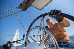 Skipper drive a sailing boat during a race on the regatta. Sport. Stock Photos