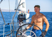 Skipper drive a sailing boat during a race on the regatta. Stock Images