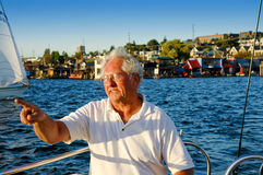 Skipper at the Helm Royalty Free Stock Photos
