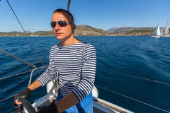 Skipper at the helm controls of a sailing yacht. Sport. Royalty Free Stock Images