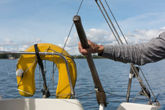 Skipper navigating. Skipper's hand navigating a yacht Royalty Free Stock Image