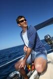Skipper on sailing boat navigating. Skipper on sailboat navigating in mediterranean sea Royalty Free Stock Photos