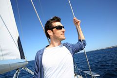 Skipper standing on sailing boat Stock Photos