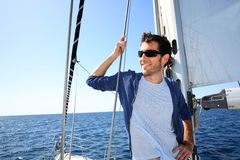 Skipper standing on sailing boat Stock Images