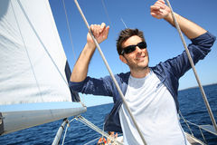 Skipper standing on y sailing boat Royalty Free Stock Photos