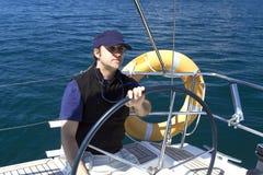 Skipper At The Wheel of A sailing boat Royalty Free Stock Photos