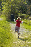 Skipping. A little girl skips up a winding path royalty free stock images