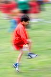 Skipping boy with movement. Royalty Free Stock Photography