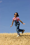 Skipping happily in a field. Stock Photography