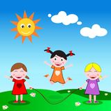 Skipping the rope. Three girls playing jumping rope outdoor in a sunny day Stock Image